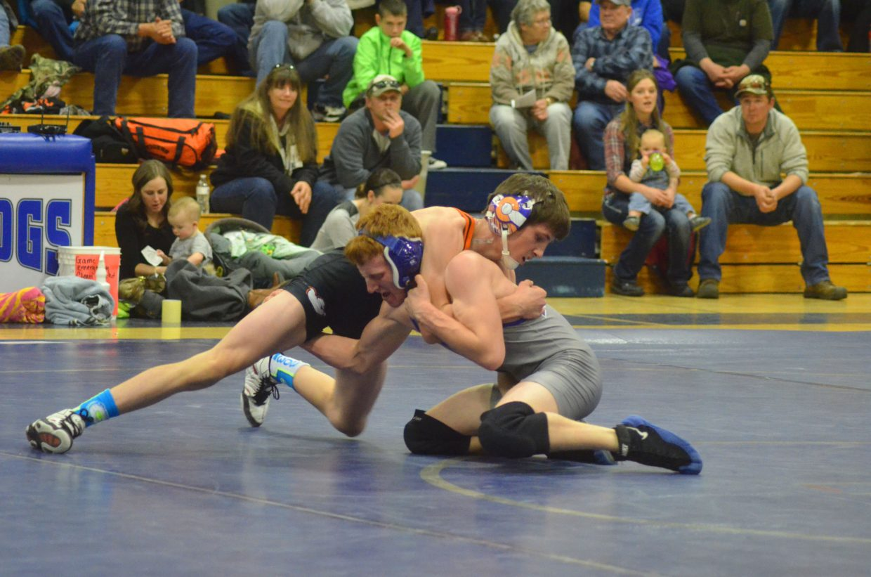 Hayden High School's Judd Magee, left, and Moffat County High School's Issik Herod skirmish during the Thursday meeting of the two teams in Craig. A wrestling triangular hosted by MCHS included the Bulldogs, Tigers and Basalt Longhorns, with Moffat County winning against both visiting teams.