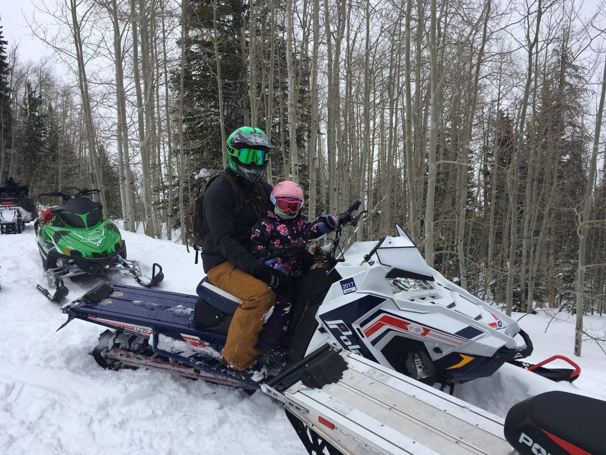Arlea Pingley joins father Eric on the back of his snowmobile during Jan. 21's annual Northwest Colorado Snowmobile Poker Run. 3-year-old Arlea was the youngest participant in the ride around Freeman Reservoir.