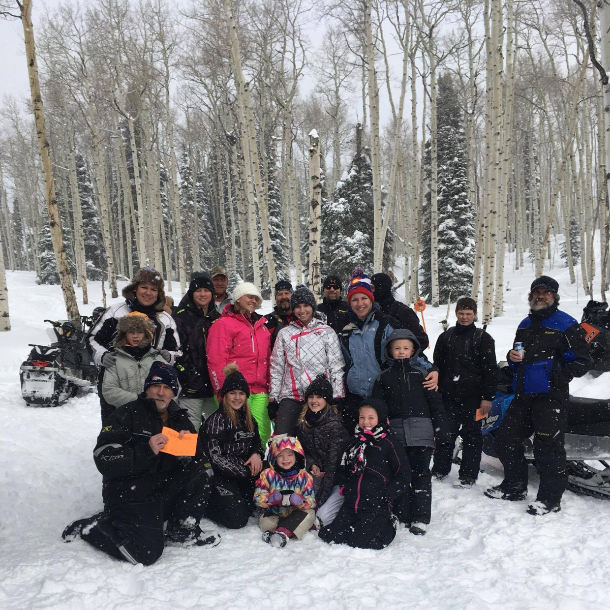 Riders gather together between stops at Jan. 21's annual Northwest Colorado Snowmobile Poker Run. Participants collected playing cards at stations around Freeman Reservoir trails, with the winner having the best hand.