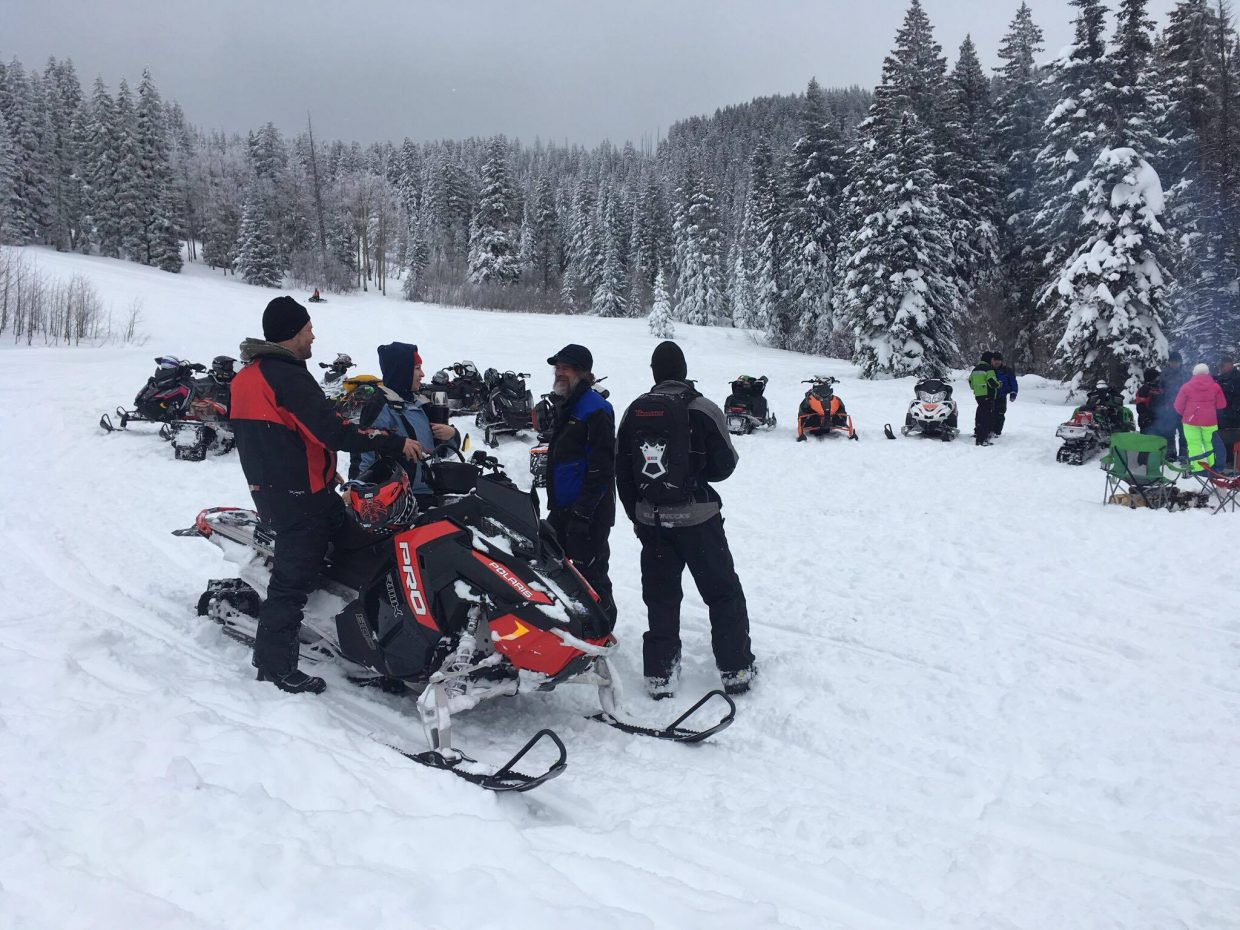 Participants stop and mingle and enjoy the wintry landscape at Freeman Reservoir during the annual Northwest Colorado Snowmobile Poker Run.
