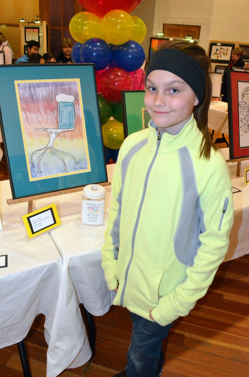 Ridgeview Elementary School fourth-grader Brook Wheeler, 10, shows off her artwork during a preview of the Cherish the Little Things Art Show at Center of Craig, 601 Yampa Ave. Wheeler was among the top 20 artists, whose art will be used for the Connections 4 Kids calendar.