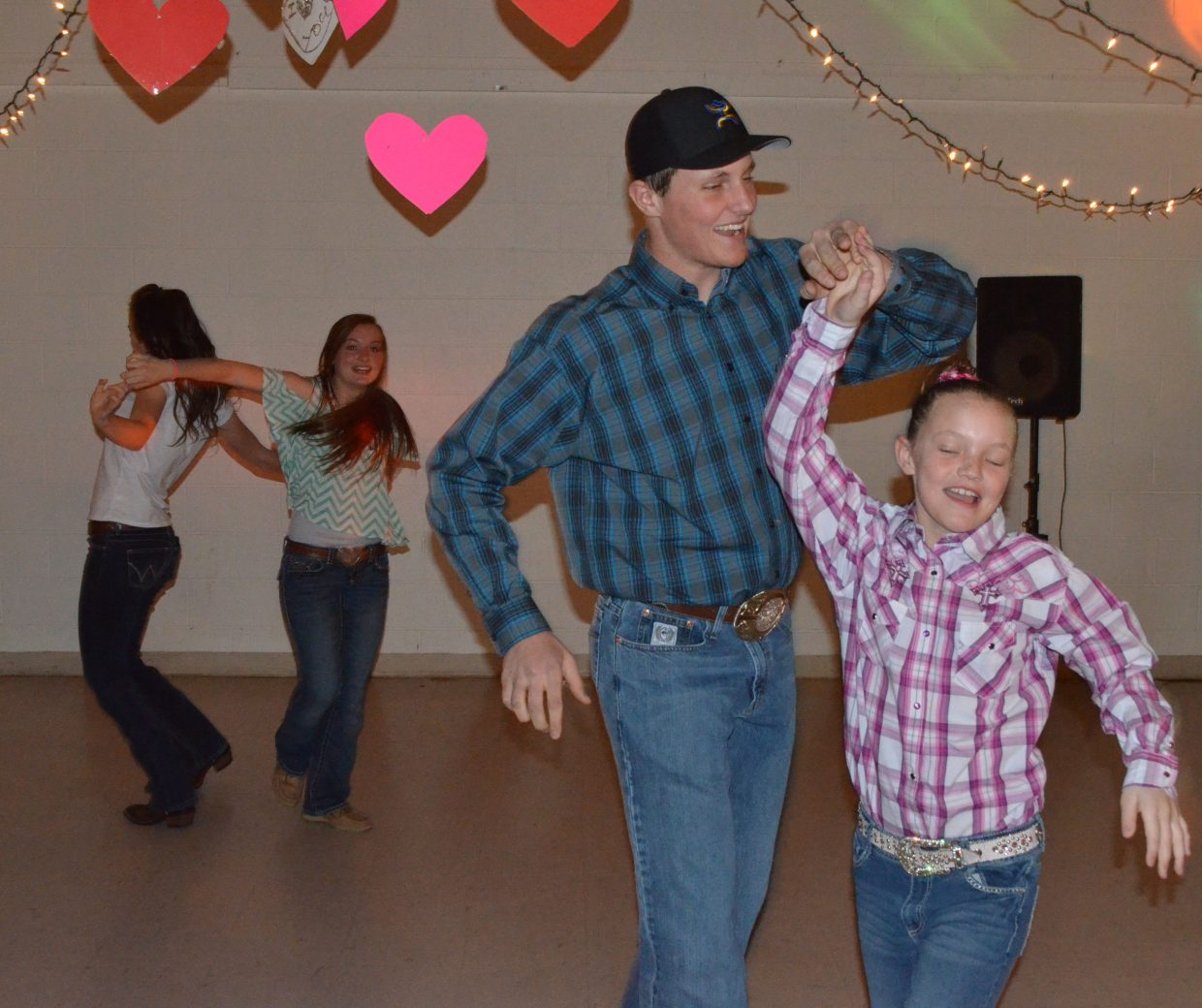 Young dancers including Toryn Hume and sister Taylen, foreground, take a spin on the dance floor at Center of Craig during the Valentine's Dance as part of Art Walk and Taste of Chocolate.