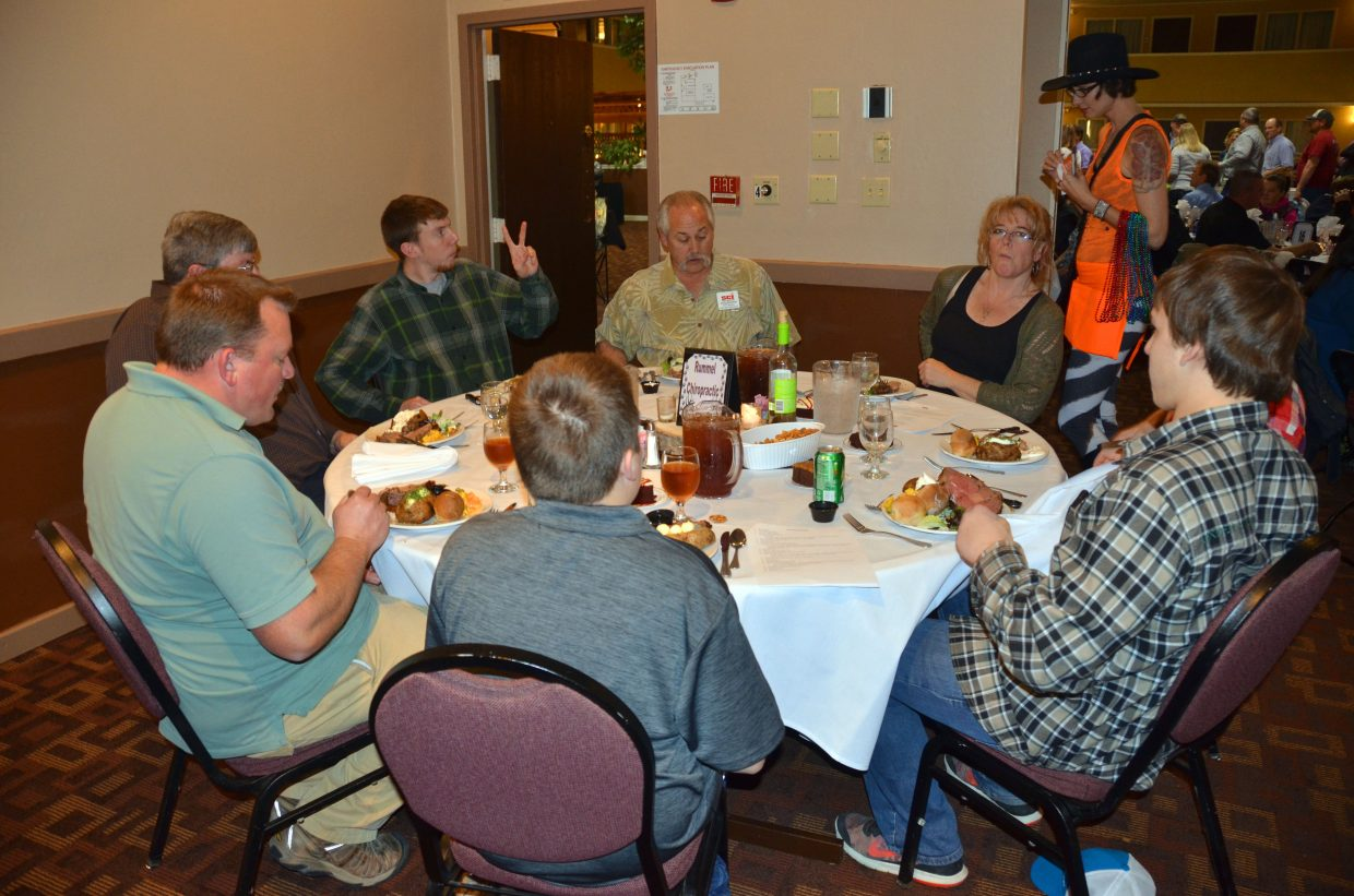 Diners enjoy the fine food and drink available at the eighth annual fundrasier banquet for Safari Club International Yampa Valley Chapter Saturday night at the Clarion Inn & Suites. Nearly 200 people were in attendance to support the organization.