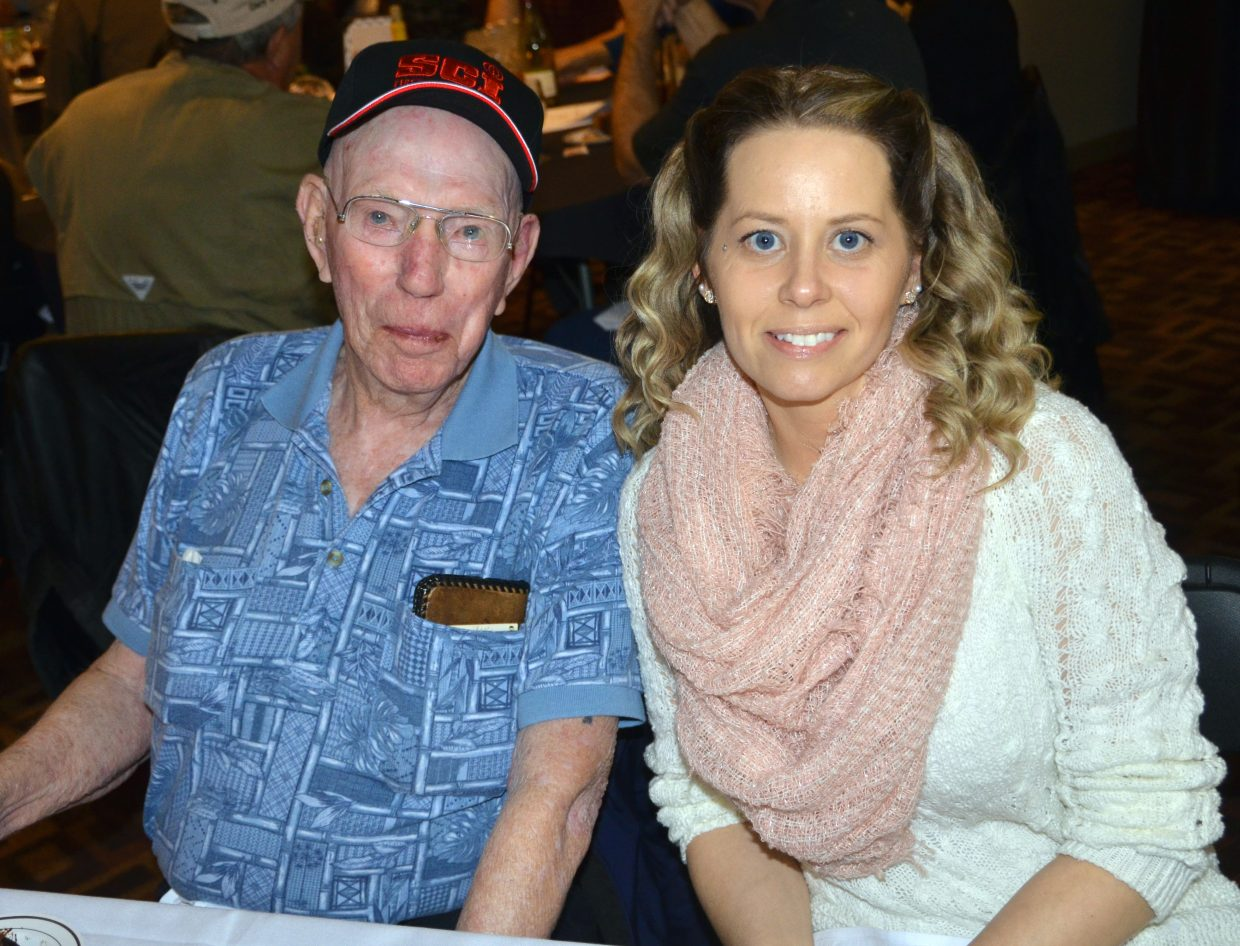 Military veterans Elmer Beights and Sydney Medina smile together during the fundraiser banquet for Safari Club International Yampa Valley Chapter Saturday in Craig. The two, both from Grand Junction, were the recipients of SCI's veteran hunting program last August, participating in an antelope harvest in Northwest Colorado. Both vets served in the Navy, Beights during World War and Medina as part of Operation Iraqi Freedom and Operation Enduring Freedom.