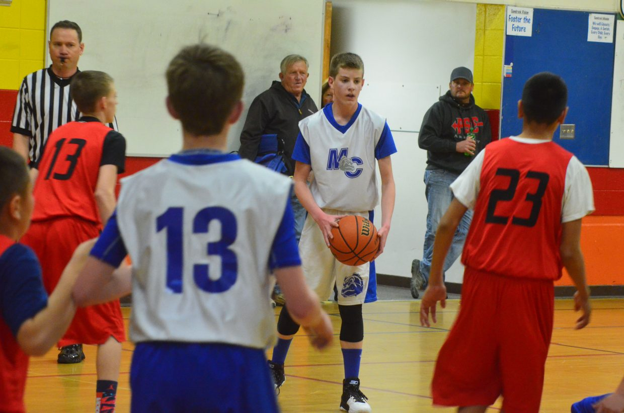 Moffat County basketball player Wes Counts looks to pass during the seventh-grade boys AAU basketball game against Parachute. The Bulldogs lost in overtime, 40-39, to Grand Valley, bouncing back to beat them, 27-21 in a rematch.