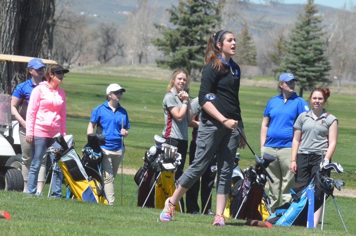 Moffat County High School's Julia Christensen follows her opening drive at Yampa Valley Golf Course while teammates and players from Rifle and Palisade look to follow her. MCHS girls golf shot 324 at the home triangular Thursday , which Rifle won with a 262.