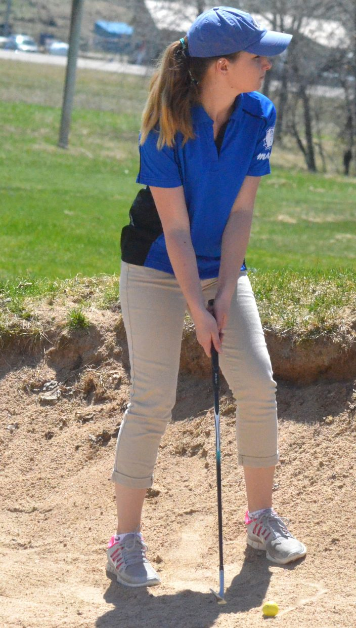 Moffat County High School's Brooke Krause seeks to get out of the sand trap on the sixth hole at Yampa Valley Golf Course.