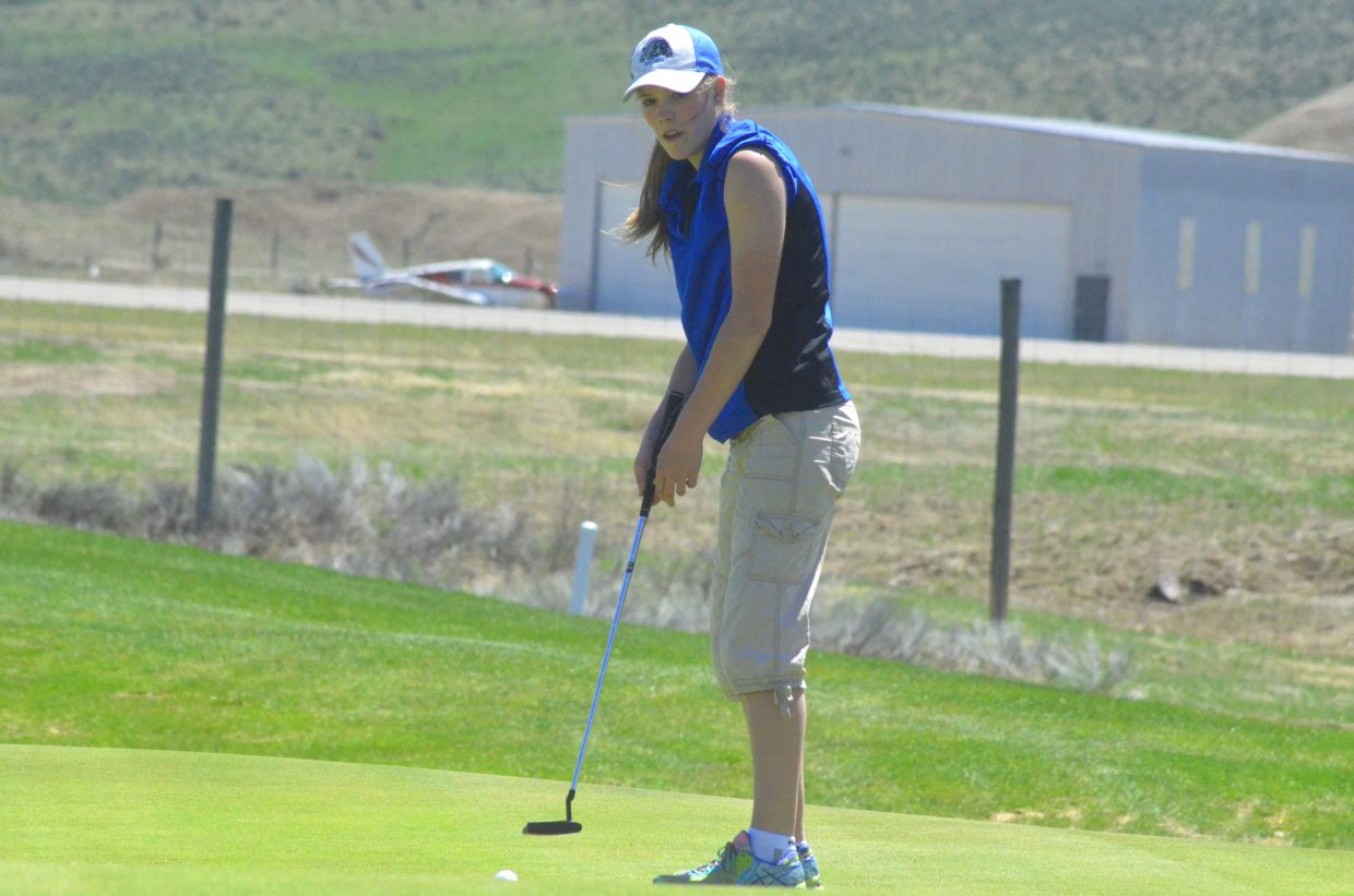 Moffat County High School's Jaci McDiffett watches her ball head for the hole on the sixth green of Yampa Valley Golf Course.