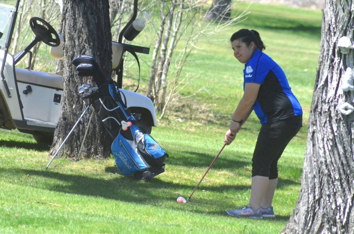 Moffat County High School's Hali Reyes looks to get out of a tight situation at Yampa Valley Golf Course.