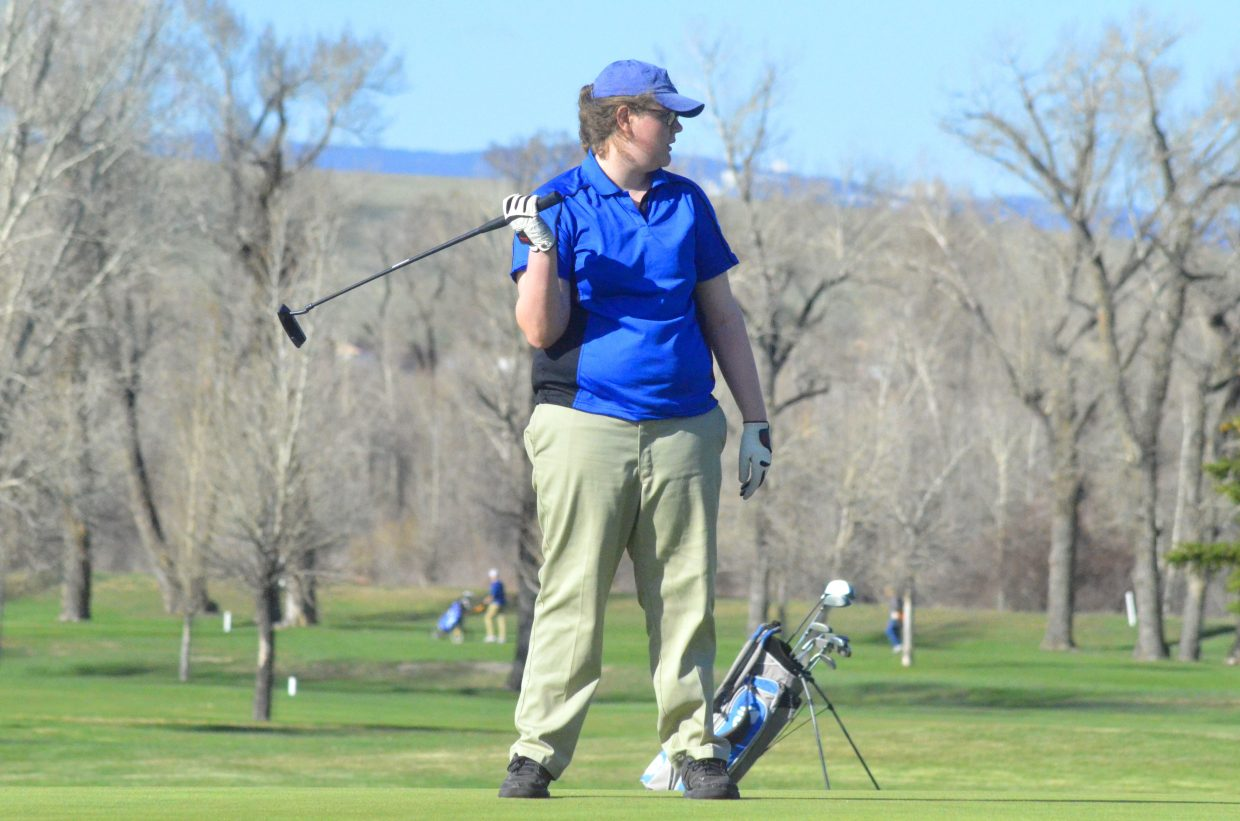 Moffat County High School's Edyn Curtis finishes out her day on the 18th hole at Yampa Valley Golf Course.