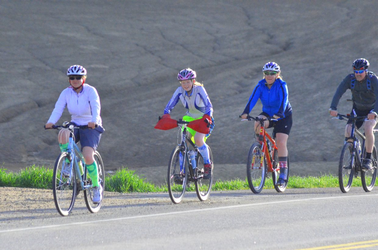 """Riders stick together during Saturday morning's """"Where the Hell's Maybell?"""" excursion. More than 130 cyclists turned out for the 30th annual bike ride from Craig to Maybell put on by Craig Parks & Recreation."""