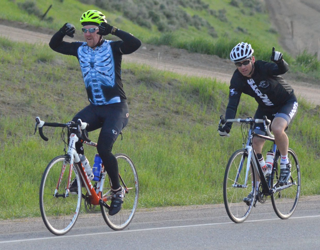 """Experienced cyclists show off for the camera while riding along US Highway 40 during Saturday morning's """"Where the Hell's Maybell?"""""""