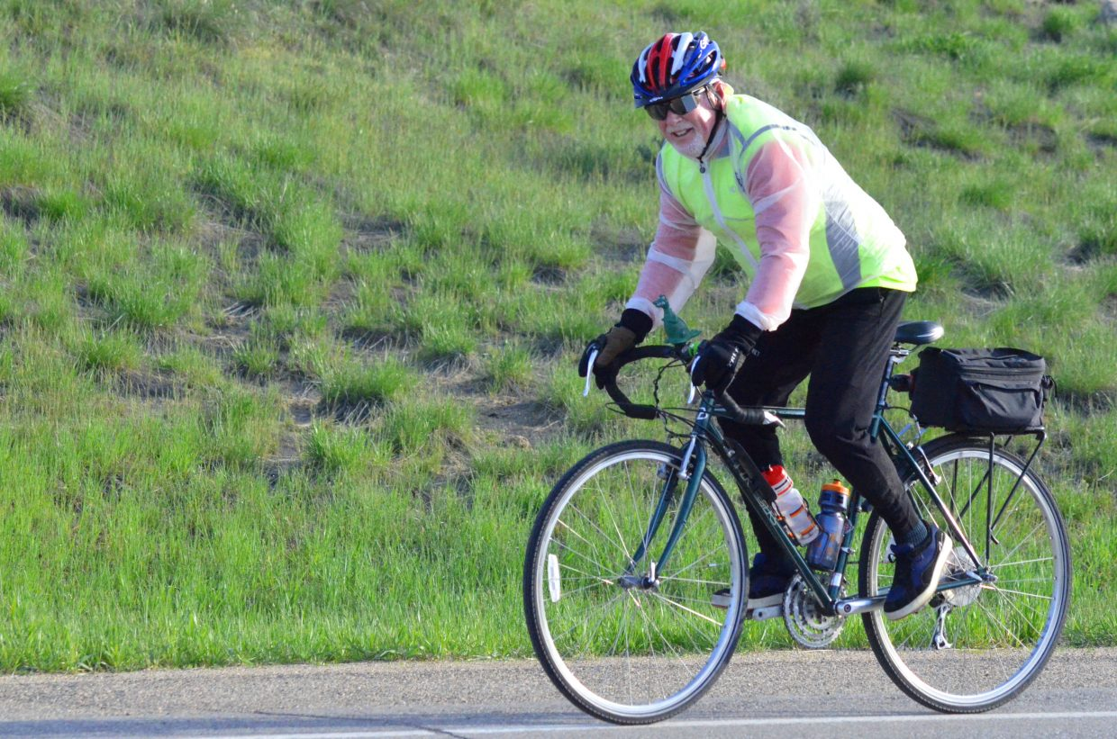 """Craig's Terry Carwile stays chipper atop his bicycle on US Highway 40 during Saturday morning's """"Where the Hell's Maybell?"""""""
