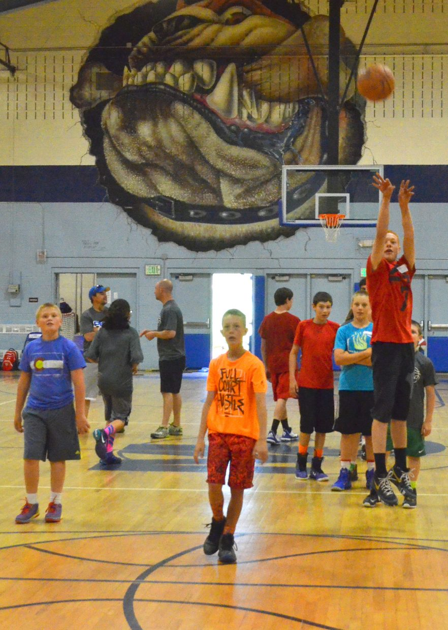 Craig attendees of the Progressive Basketball Academy shoot around and warm up for the day ahead in the Moffat County High School gym.