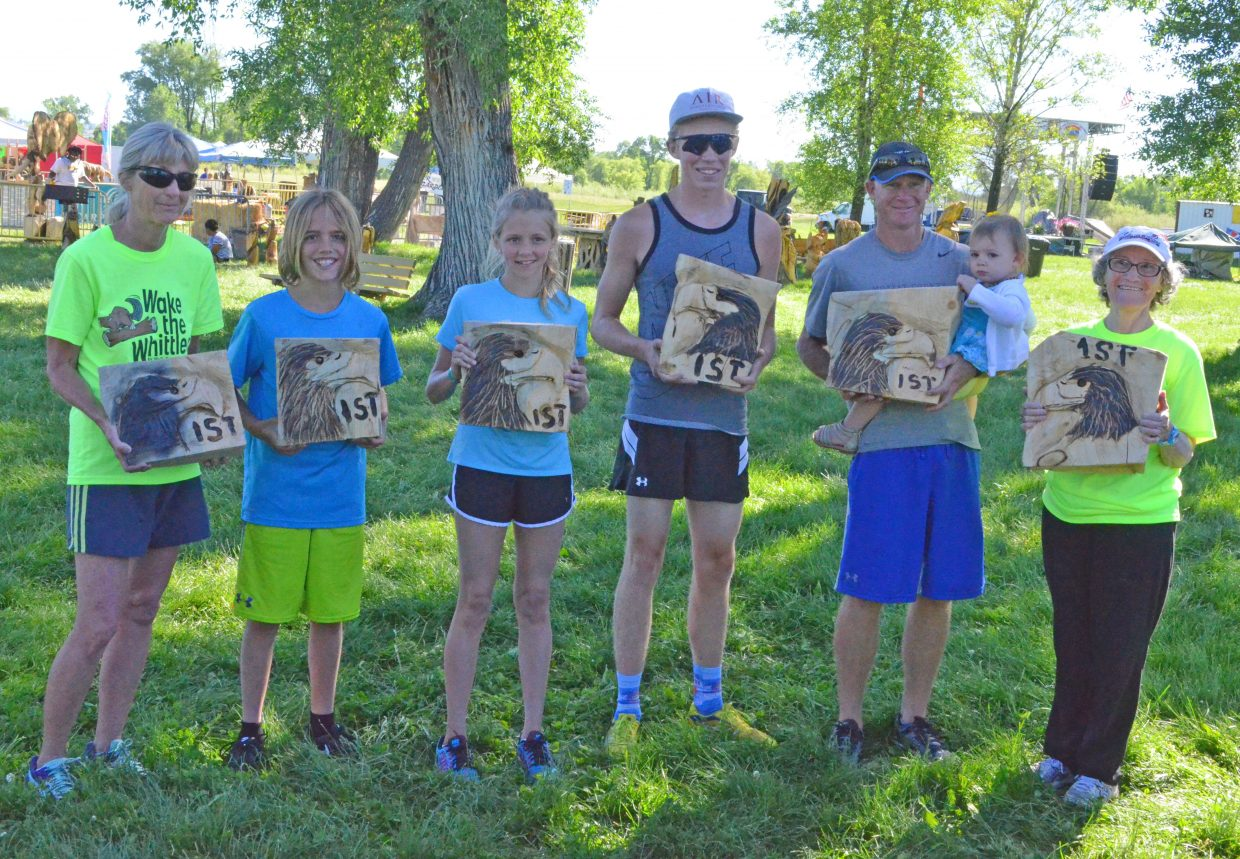 Winners of the fifth annual Wake the Whittler hold up their first place honors. From left, Penny Murphy, Owen Gifford, Emma Jones, Riley Allen, Todd Trapp and Bertha McMillen. Additional winners included Allan Reishus and Hayden's Makenna Knez. The top honors were given to the fastest male and female runners in the age groups 12 and under, 13 to 18, adults 19 and older and seniors.