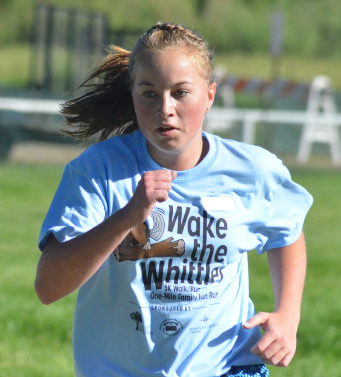 Hayden's Makenna Knez looks to finish strong in the Wake the Whittler 5K Saturday morning. Knez, who also runs cross country for Moffat County High School, had the best overall time among female runners.