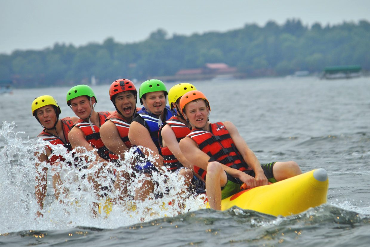 From left, Bear River Young Life members Mike Bingham, Isaac Chacon, Hugo Hernandez, Brett Bailey, Nate Gatlin and Cole Hoth cruise on a banana boat on Pelican Lake as part of Castaway Club Young Life Camp.