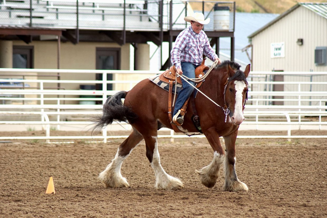 Grady Anson rides his draft horse Rocket in the senior division of the Western Horsemanship class at this year's Moffat County Fair.