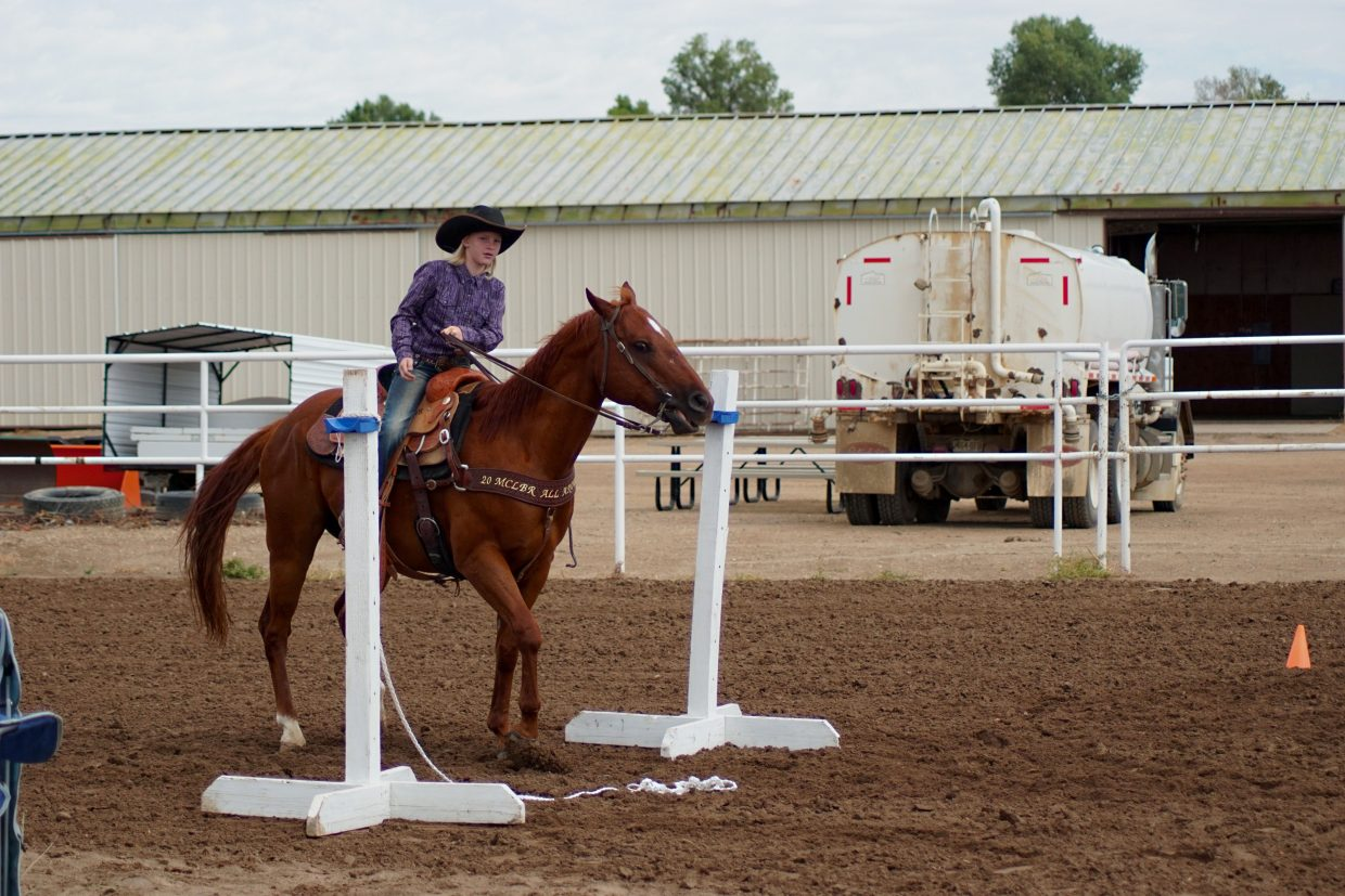 Katie Jo Knez rides T.C. through the course during the Western Trail competition at the 2016 Moffat County Fair.