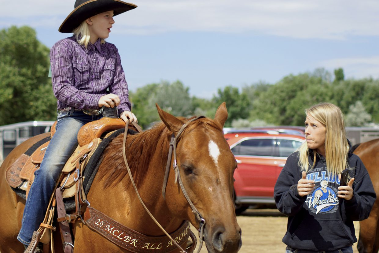 Erin and Katie Jo Knez go over the pattern that Katie and T.C. would ride in the Western Reining competition.