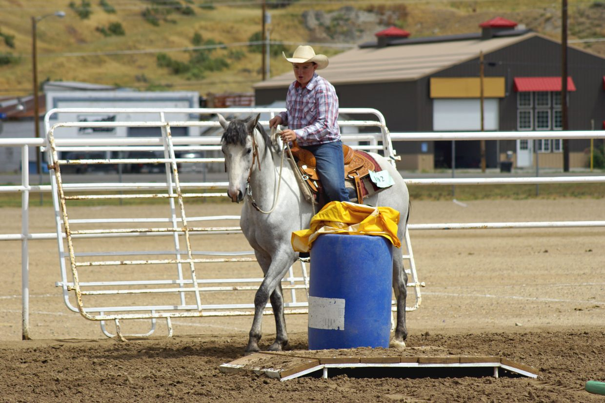Grady Anson, who usually rides draft horses, encourages his 3-year-old saddle bred colt Danny through the Western Trail course on the first day of events at the Moffat County Fairgrounds.