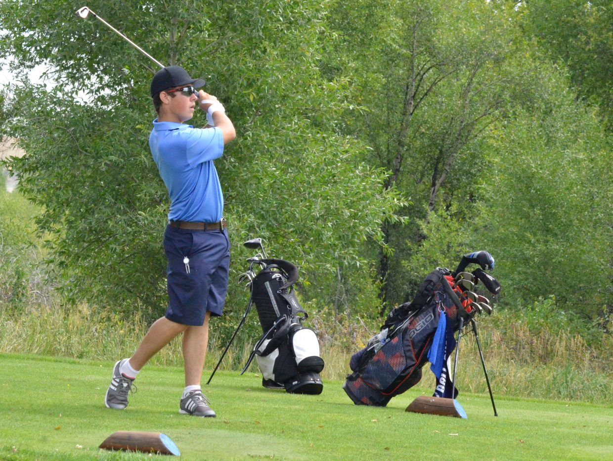 Moffat County High School senior Mike Bingham swings for the green on the Par 3 16th hole of Yampa Valley Golf Course Monday. Bingham shot a 76 to place seventh of 69 players in the MCHS Invitational.