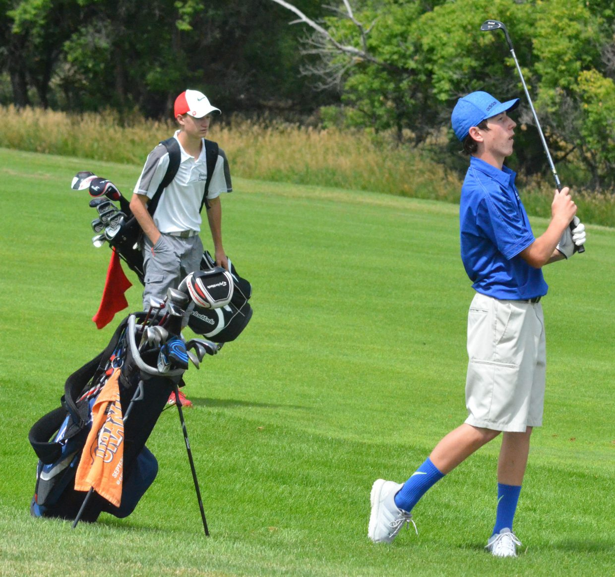 Moffat County High School sophomore Connor Etzler chips from the 17th fairway of Yampa Valley Golf Course Monday during the MCHS Invitational. Etzler shot a 91 for the day.