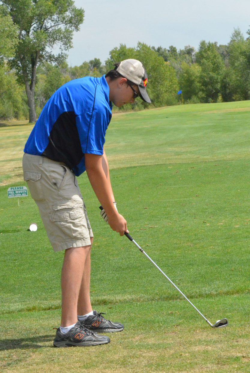 Moffat County High School junior Gage Rowley readies himself on the seventh tee of Yampa Valley Golf Course Monday during the MCHS Invitational.