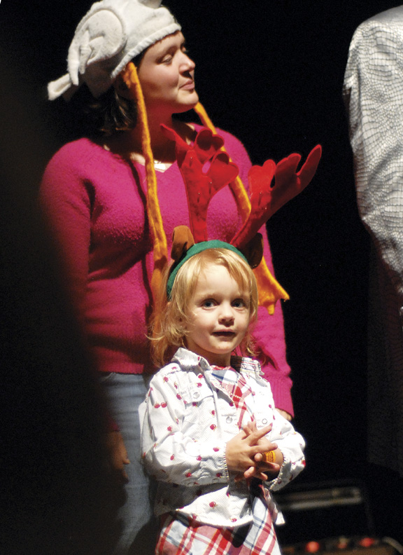 """Cara Rayburn and her daughter Angel, 3, of Craig, get ready to do the """"Chicken Dance"""" during the """"Magic Magic Magic"""" show Saturday night."""