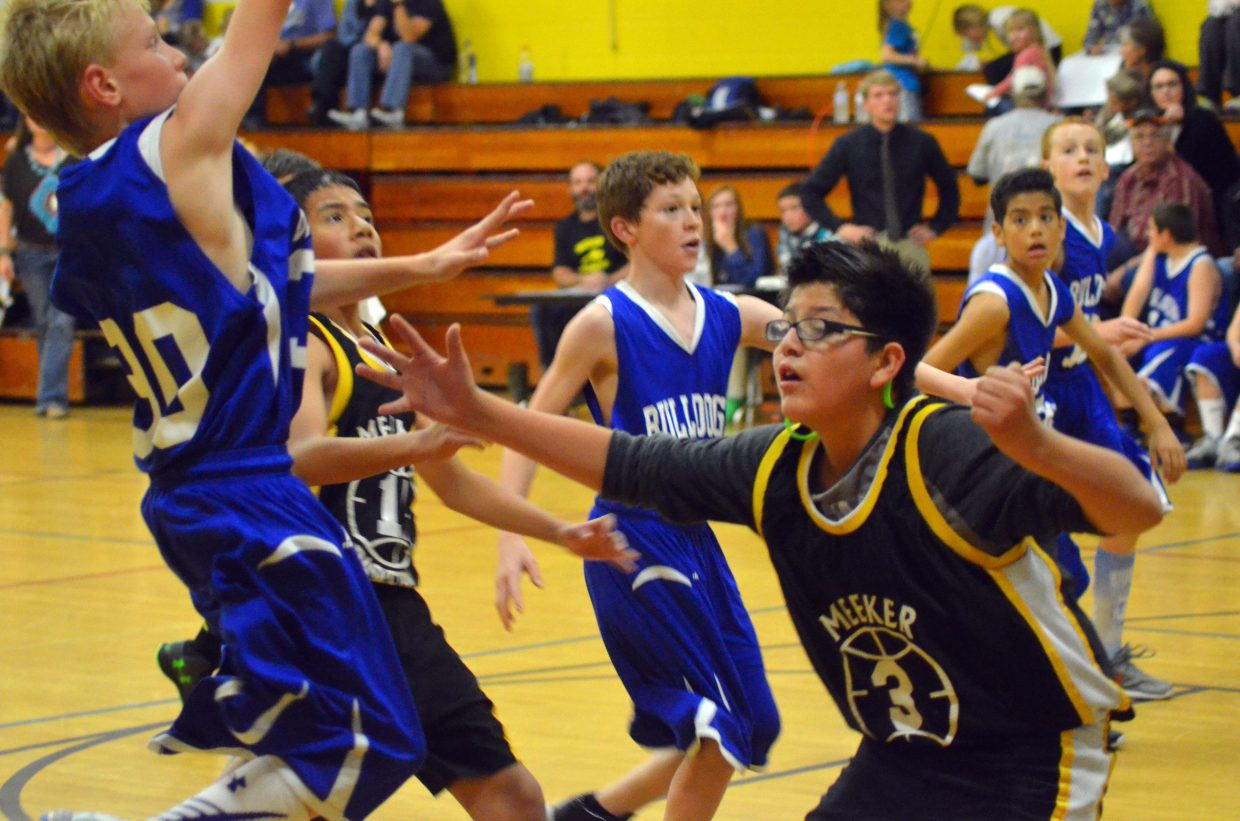 Chris Maneotis (30) takes a shot during the Craig Middle School seventh-grade B-Team's Thursday game against Meeker in the Sandrock Elementary School gym. The Bulldogs lost, 14-13.