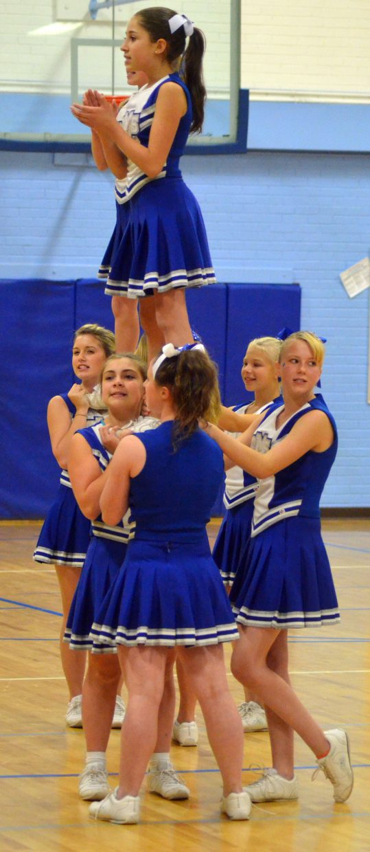 Craig Middle School cheerleaders pep up the crowd Thursday during halftime of the eighth-grade boys basketball game.