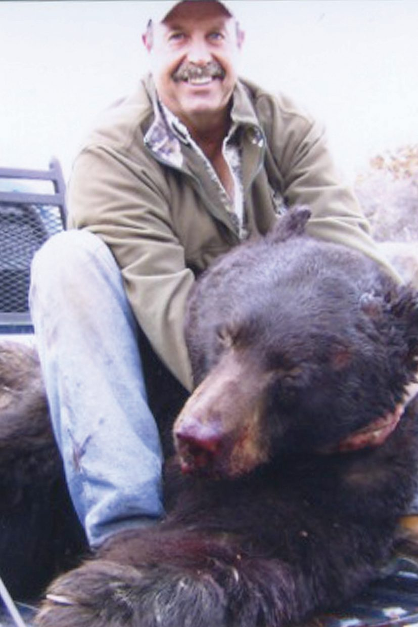Richard Kendall, 56, holds the head of the 703-pound black bear he killed Nov. 20 in the Wilson Creek area of Moffat County. Kendall hopes the kill will be the new state record for a black bear.