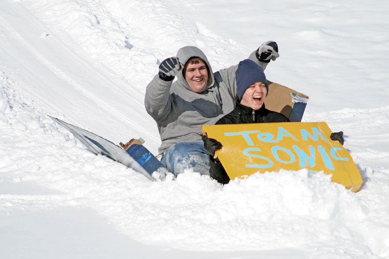 The sled of Team Sonic breaks apart midway through the 2011 Science Olympics Cardboard Sled Races.