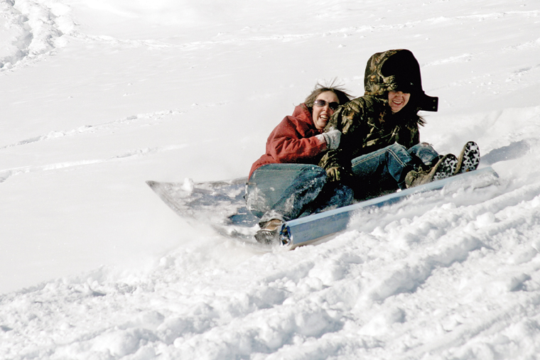 MCHS students Kirstie McPherson, left, and Mary Penner participate in the 2011 Science Olympics Cardboard Sled Races.