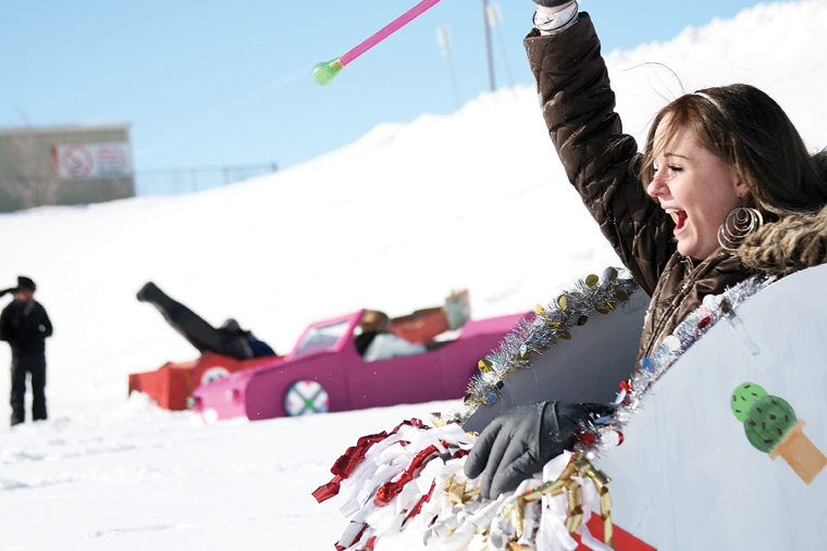 April Rogers, a Moffat County High School junior, celebrates after finishing the 2011 Science Olympics Cardboard Sled Races. Forty-six students, making up 16 teams, competed Wednesday afternoon below the MCHS parking lot.
