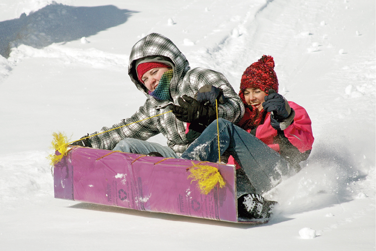 MCHS seniors Austin Lee, left, and Amanda Brewer pick up speed Wednesday during the 2011 Science Olympics Cardboard Sled Races.
