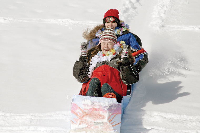 MCHS students Velvet Warne, front, and Amie Chadwick compete during the 2011 Science Olympics Cardboard Sled Races. The pair won top honors for traveling the greatest distance in their sled, which they named Coconut.