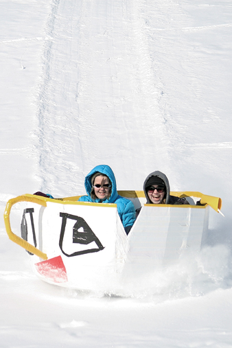 """MCHS seniors Kellie Looper, left, and Kaci Meek compete during the 2011 Science Olympics Cardboard Sled Races. The pair won for the most creative sled, called Chip, based on the Walt Disney animated film, """"Beauty and the Beast."""""""