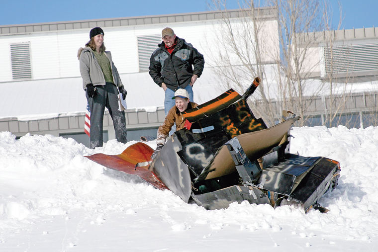 MCHS freshman Cody McDermott is shown near his wrecked sled during a tough start at the 2011 Science Olympics Cardboard Sled Races. The sled broke apart shortly after crossing the starting line, and garnered the three-man team an award for best crash.
