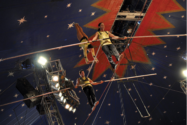 """Carson and Barnes Circus performers walk the tightrope Tuesday afternoon during the first of two performances at the Moffat County Fairgrounds. The self-proclaimed """"world's biggest big-top show"""" also offered elephant rides and a petting zoo."""