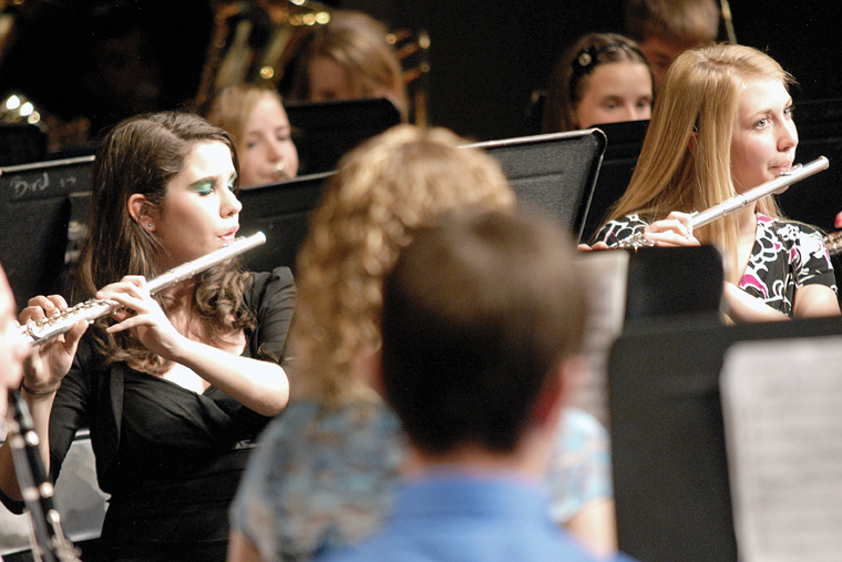 Craig Middle School seventh-graders Katie Kennedy, left, and Samantha Ahlmer play the flute at Thursday's concert in honor of Craig Smith.