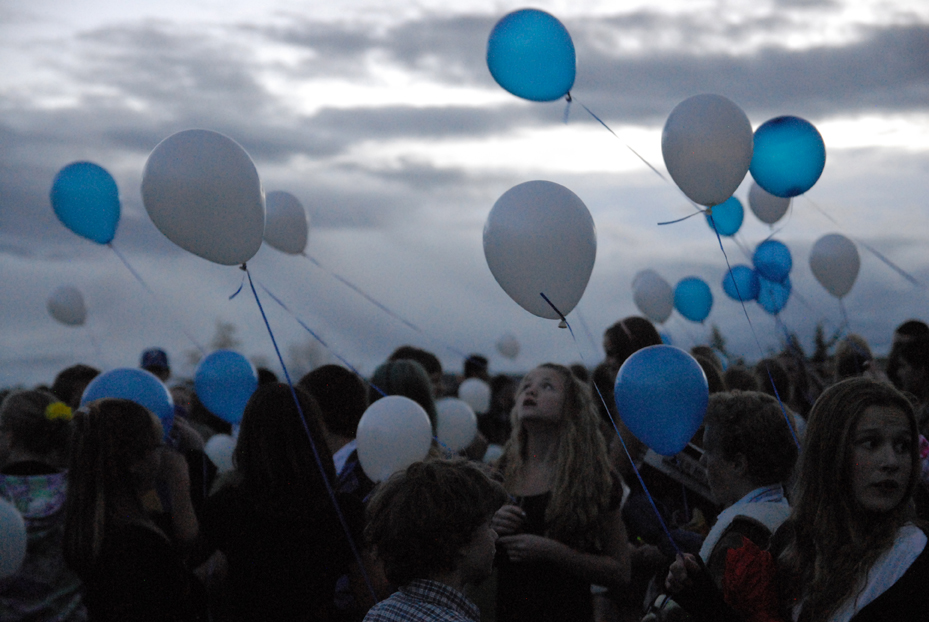 Blue and white balloons play in the breeze Thursday on the Moffat County High School football field. Hundreds of students, teachers and community members turned out for a farewell concert and balloon release for Craig Middle School band teacher Craig Smith who died Sunday. He was 64.