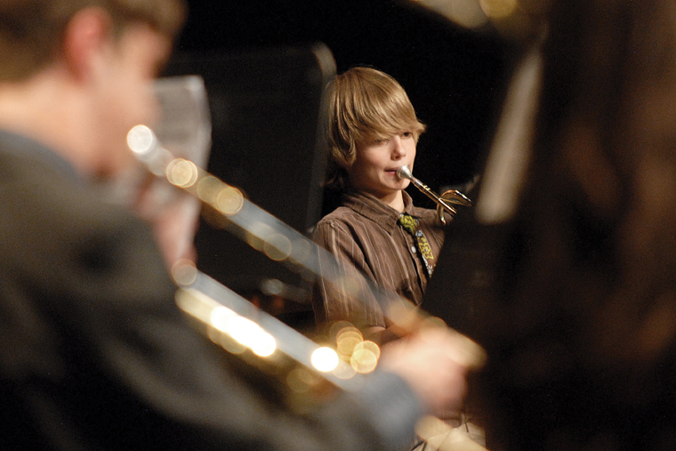Craig Middle School seventh-grader Wyeth Krumrey plays trumpet Thursday on the stage of the Moffat County High School auditorium. The concert memorialized CMS band teacher Craig Smith who died Sunday.