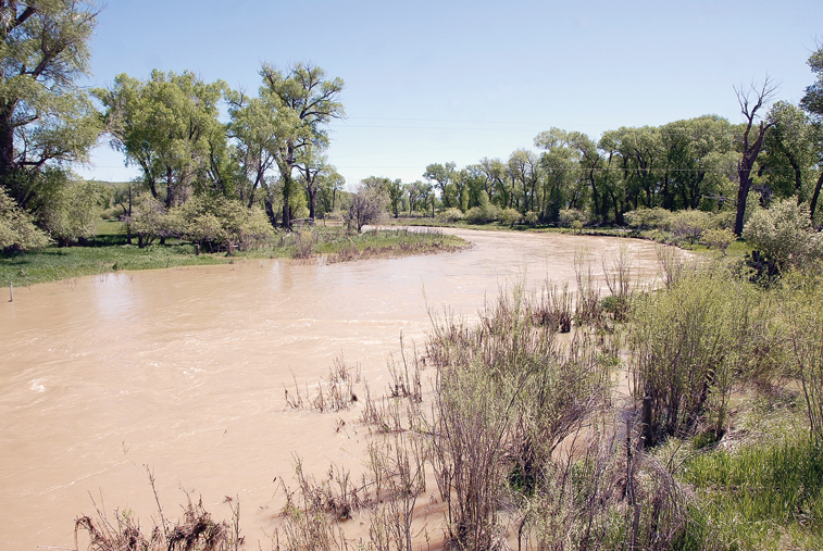 The Elkhead River, just east of Craig, spills its banks just before it passes under U.S. Highway 40 toward its confluence with the Yampa River.