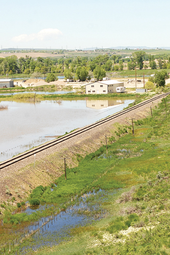 Northwest Ready Mix, east of Craig, is reflected in the rising floodwaters Wednesday.