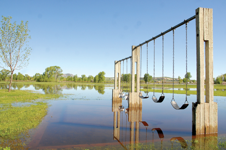 A play area on the north side of Loudy-Simpson Park is flooded due to rising water from the Yampa River.