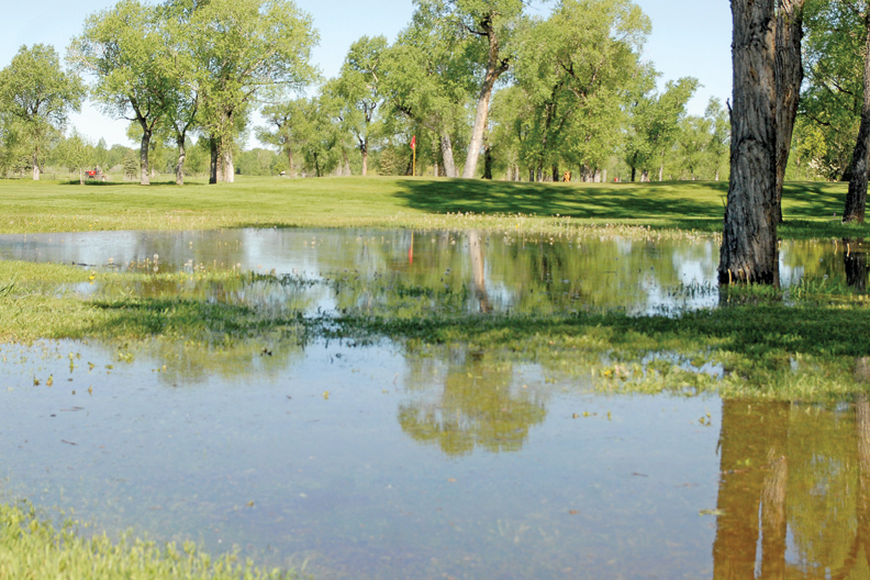 Floodwater sits just east of the seventh green Wednesday at Yampa Valley Golf Course.