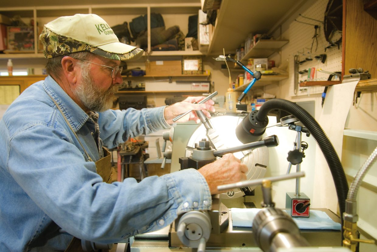 Kelley uses a lathe, which is one of the many large tools he uses to manufacture parts for guns, Tuesday.
