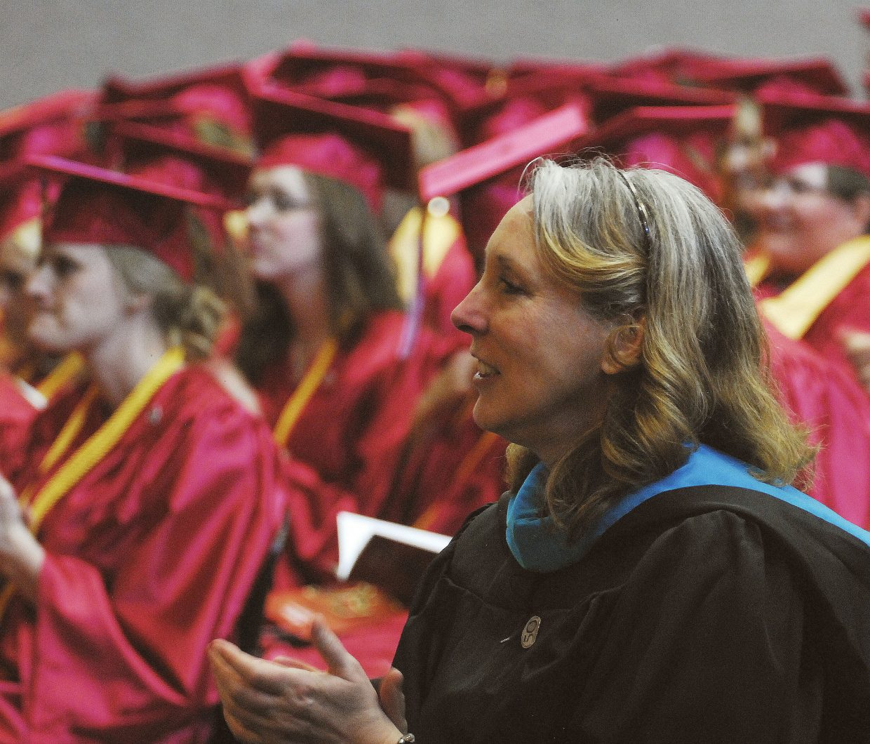 Kathryn Deitz, instructor of psychology and sociology at the CNCC Craig campus, enjoys the graduation ceremony May 11. The entire faculty and staff of both campuses joined together to encourage graduates.