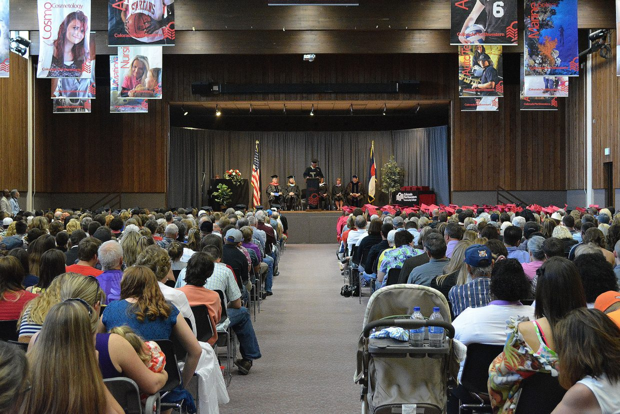 Moffat County Board of Control President Jim Laughran addresses the crowd of nearly 500 in the Colorado Room of the Weiss Student Center on CNCC's Rangely campus May 11 during the school's commencement ceremony.